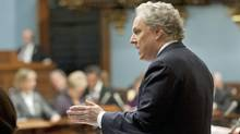 Premier Jean Charest defends his government's enforcement of Bill 101, Quebec's language law, during debate at the National Assembly on Dec. 8, 2011. (Jacques Boissinot/Jacques Boissinot/The Canadian Press)