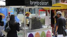 The Toronto a la Cart food stand located at Nathan Phillips Square in 2009. It was part of Toronto's failed pilot program to provide a wider variety of food cart options. (Kevin Van Paassen/The Globe and Mail)