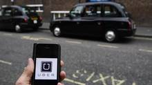 A photo illustration shows the Uber app logo displayed on a mobile telephone, as it is held up for a posed photograph in central London, Britain Oct. 28, 2016. (Reuters)