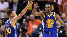 Golden State Warriors guard Stephen Curry and forward Kevin Durant celebrate during the fourth quarter of Game 3. (Ken Blaze/USA Today Sports)