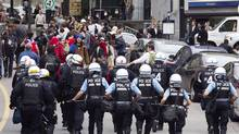 Police chase student protesters in Montreal, May 15, 2012. (CHRISTINNE MUSCHI/REUTERS)