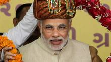 Gujarat Chief Minister Narendra Modi accepts a garland during a ceremony on Jan. 20, 2012. (Ajit Solanki/Associated Press/Ajit Solanki/Associated Press)