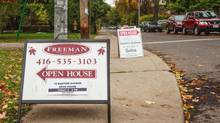 Signs for open houses are seen in Toronto's Annex neighbourhood on Oct. 14, 2012. (Jennifer Roberts For The Globe and Mail)