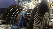 A technician inspects the blades of a turbine during a planned maintenance intervention at the Bugey nuclear power plant in Saint-Vulbas, near Lyon April 19, 2011. Electricite de France (EDF) runs the country's 58 nuclear reactors, which meet close to 80 percent of the country's power needs and which its rivals say give the state-owned company a competitive advantage. (Benoit Tessier/Reuters)