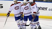 Montreal Canadiens' Francis Bouillon, centre, Tomas Plekanec, left, and P.K.Subban celebrate Bouillon's goal against the Florida Panthers during the second period of their NHL hockey game in Sunrise, Florida March 10, 2013. (RHONA WISE/REUTERS)