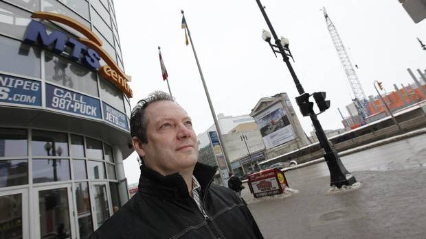 Doug McKay, director of commercial development for Longboat Development Corporation, stands outside the MTS Centre in Winnipeg, the new hockey arena and home to the Winnipeg Jets. Across the street, Longboat's Centrepoint project is under construction. The return of the NHL has helped to fuel the first commercial real estate boom in downtown Winnipeg in decades. (John Woods for The Globe and Mail)