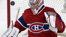 Montreal Canadiens goalie Carey Price (31) keeps his eyes on the puck during third period NHL action against the Dallas Stars in Montreal on Tuesday, October 29, 2013. Montreal won the game 2-1. (Ryan Remiorz/THE CANADIAN PRESS)