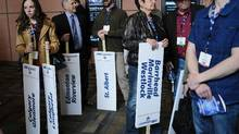 Delegates hold riding signs at the Alberta PC Party leadership convention in Calgary, Alta., Friday, March 17, 2017. (Jeff McIntosh/THE CANADIAN PRESS)