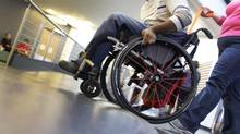 Canada's disabled citizens face ongoing challenges to their well-being, including barriers to language and communication, learning and training, and safety and security, says a new report. (PETER POWER/THE GLOBE AND MAIL)