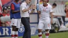 Canada's head coach John Herdman talks to Desiree Scott, right, during the international women's friendly soccer match between Germany and Canada in Paderborn, Germany, Wednesday, June 19, 2013. Canada takes on South Korea in exhibition play at Commonwealth Stadium on October 30. (MARTIN MEISSNER/AP)