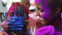Brightly coloured chalk powder is a hallmark of Phagwa, a Hindu spring festival. Indentured workers from India brought the celebration to the islands decades ago. (ANDREA DE SILVA/REUTERS)