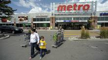 Shoppers leave a Metro store in Toronto. (Fred Lum/Fred Lum/The Globe and Mail)