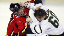 Dallas Stars' Antoine Roussel fights with Calgary Flames' Jarome Iginla (Jeff McIntosh/The Canadian Press)