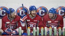 From left to right: Brian Gionta, Max Pacioretty and Thomas Vanek, right, joke around on Friday during practice. (Graham Hughes/THE CANADIAN PRESS)