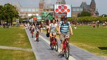 We're visiting Amsterdam and want to go biking. Where ...