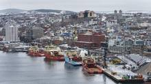 Ocean-going tugboats servicing oil rigs are seen moored in the harbour in St. John's, N.L. on March 10, 2016. While some people are inclined to view the drop in commodity prices, especially oil, as something affecting one region and one sector of the economy, Canadian executives say the negative ramifications are significant throughout the economy, across the country. (Darren Calabrese For The Globe and Mail)