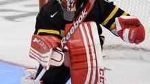 'When playing with guys, you see and hear a lot more stuff you need to deal with, which has made me thick-skinned and mentally tough,' says Team Canada goaltender Shannon Szabados. (Sean Kilpatrick/THE CANADIAN PRESS)