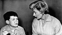 A still image from a Leave it to Beaver episode broadcast Oct. 1, 1960. June Cleaver is trying to understand why Beaver won't eat his vegetables. (ABC)