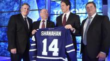 Leaf brass at a press conference Monday at Toronto's Air Canada Centre. From left, Tim Leiweke, MLSE president and CEO; Larry Tanenbaum, MLSE chairman; new Leafs president Brendan Shanahan; and Leafs VP and GM Dave Nonis. (Fred Lum/The Globe and Mail)
