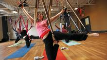 Yoga Instructor Beatrix Montanile works with her OmGym class at Hands On You in Toronto. (Deborah Baic/The Globe and Mail/Deborah Baic/The Globe and Mail)