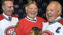 Montreal Canadiens and Chicago Blackhawks hockey legends Guy Lafleur, Bobby Hull and Yvan Cournoyer , left to right, share a laugh prior to a ceremony Tuesday, Jan. 8, 2008 in Montreal. THE CANADIAN PRESS/Paul Chiasson (Paul Chiasson)