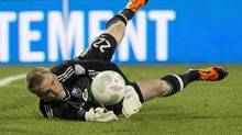 Montreal Impact goalkeeper Eric Kronberg makes a save as they face the Toronto FC during second half Amway Canadian soccer championship semifinal action Wednesday, May 6, 2015 in Montreal. (Paul Chiasson/THE CANADIAN PRESS)