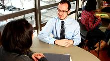 Career Advisor Jennifer Coombs speaks with student Eric Snow in Halifax (PAUL DARROW/GLOBE AND MAIL)
