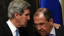 Russia's Foreign Minister Sergei Lavrov (R) and U.S. Secretary of State John Kerry speak during a joint news conference after their meeting in Moscow, May 7, 2013. (SERGEI KARPUKHIN/REUTERS)