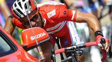 """Katusha Team's Joaquin """"Purito"""" Rodriguez of Spain talks with his director as he cycles during the seventh stage of the Tour of Spain """"La Vuelta"""" cycling race between Huesca and Alcaniz August 24, 2012. ) (FELIX ORDONEZ/REUTERS)"""