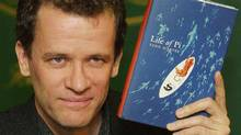 Yann Martel with his award-winning novel Life of Pi.