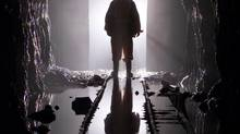 A miner is silhouetted as he passes through a doorway in a mine shaft at the Giant Mine near Yellowknife. Giant Mine is one of the so-called Big Five contaminated sites in Canada. It was not included in a recent Parliamentary Budget Office analysis of the estimated costs of cleaning up Canada's contaminated sites, but the PBO report warned that 'both the general inventory sites and the Big Five will likely see increases over and above those currently reported.' (ADRIAN WYLD/THE CANADIAN PRESS)
