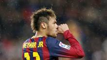 Barcelona's Neymar celebrates his second goal against Celta de Vigo during their La Liga's soccer match at Nou Camp stadium in Barcelona March 26, 2014. (GUSTAU NACARINO/REUTERS)