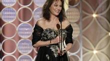 This image released by NBC shows Jacqueline Bisset accepting the award for best supporting actress in a series, mini-series or TV movie for her role in, Dancing on the Edge during the 71st annual Golden Globe Awards at the Beverly Hilton Hotel on Sunday, Jan. 12, 2014, in Beverly Hills, Calif. (Paul Drinkwater/AP)
