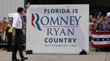 Republican presidential nominee Mitt Romney waves to supporters as he walks to his campaign plane after a campaign rally at the airport in Sanford, Florida November 5, 2012. (BRIAN SNYDER/REUTERS)