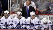 Toronto Maple Leafs head coach Randy Carlyle is pictured behind the bench while his team take on the Vancouver Canucks during the second period of their NHL hockey game in Vancouver, British Columbia November 2, 2013. (Reuters)