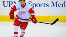 Pavel Datsyuk, seen taking the pregame warmup Thursday night in Pittsburgh, will return to the lineup Saturday for the fifth game of the Stanley Cup final. (Harry How/Harry How/Getty Images)