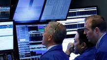 Traders work on the floor of the New York Stock Exchange (NYSE) April 20. (BRENDAN MCDERMID/REUTERS)