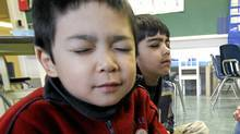 Kindergarten students Ivan Wong, Ali Hooda close their eyes during a mindful breathing exercise at Renfrew Elementary in Vancouver, BC. (Laura Leyshon for the Globe and Mail/Laura Leyshon for the Globe and Mail)