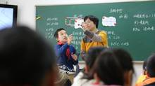Su Jin teaches basic geometry to a grade four class at Shanghai Luwan First Central Primary School. Shanghai math students lead international testing scores. (Nathan VanderKlippe/The Globe and Mail)