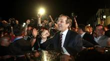 Leader of conservative New Democracy party Antonis Samaras is cheered by supporters after his statement on the election results in Athens Sunday. Mr. Samaras claimed victory in Sunday's national election, saying Greeks had voted to stay in the euro single currency. (John Kolesidis/Reuters)
