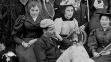 Detail of a photo of the artist Emily Carr at a tennis party. Carr is on the far left, with her mystery man leaning against her legs. (City of Victoria Archives)