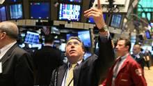 Traders work on the floor of the New York Stock Exchange. (Spencer Platt/Getty Images)