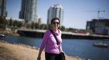Fern Davies, co-chair of the False Creek Residents Association, is photographed on Concord Pacific's nine-acre parcel of land next to the Plaza of Nations assessed at $400,000 in Vancouver. The Property Assessment Appeal Board found that a disputed parcel of land was worth close to $12-million – minus more than $17-million in costs. (Rafal Gerszak for the globe and mail)