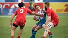 Terry Bouhraoua (C) of France is stopped by Canada during a rugby match on day two of the USA Sevens Rugby tournament, part of the World Rugby Sevens Series, March 4, 2017 in Las Vegas, Nevada. (DAVID BECKER/AFP/Getty Images)