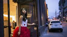 Anastasia Lin walks out of a restaurant in Toronto on Nov. 21, 2015. Ms. Lin, an outspoken advocate for human rights and religious freedom in China, was denied a visa to attend the Miss World pageant in China last year. (IAN WILLMS/New York Times)