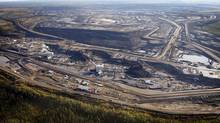 An aerial view of an oil sands mine facility near Fort McMurray, Alta. (Jeff McIntosh/CANADIAN PRESS)