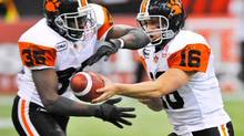 B.C. Lions' QB Buck Pierce hands off the ball to teammate Martell Mallett in this 2009 photo (Sam Leung/The Canadian Press)