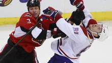 Ottawa defenceman Marc Methot, left, collides with Montreal counterpart Raphael Diaz this week. The Senators won the playoff series 4-1. (BLAIR GABLE/REUTERS)