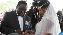 Zimbabwe's Prime Minister Morgan Tsvangirai and partner Elizabeth Macheka exchange rings after getting married under customary law in Harare, September 15, 2012. (PHILIMON BULAWAYO/REUTERS)