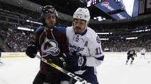 Tampa Bay Lightning center Brian Boyle (right) checks Colorado Avalanche defenseman Mark Barberio in the second period of an NHL hockey game in Denver on Feb. 19, 2017. (David Zalubowski/AP)